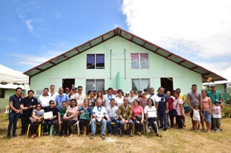 BACOLOD. Technical Education and Skills Development Authority officials turn over duplex houses to 20 families in Sagay City, under the Yolanda Rehabilitation and Recovery Program-Training Cum Production Project, in Barangay Old Sagay. (Contributed photo)