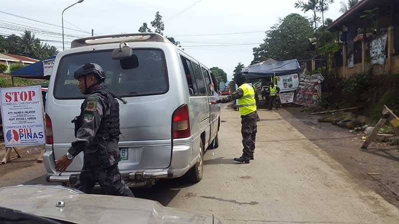 BUKIDNON. Heavy checkpoint like this one in Bukidnon hopes to crack more gun ban violators as the government intensifies security measures onward to the national and local elections in May. (Lynde Salgados)