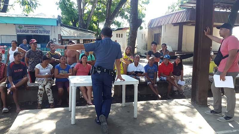 CAGAYAN DE ORO. Personnel from Regional Maritime Unit- Northern Mindanao take an effort to educate some families of fishermen in Barangay Bonbon, Cagayan de Oro, how to avail fishing vessel clearance that would clear them in any criminal offense for their day-to-day work at seawaters. (Lynde Salgados)