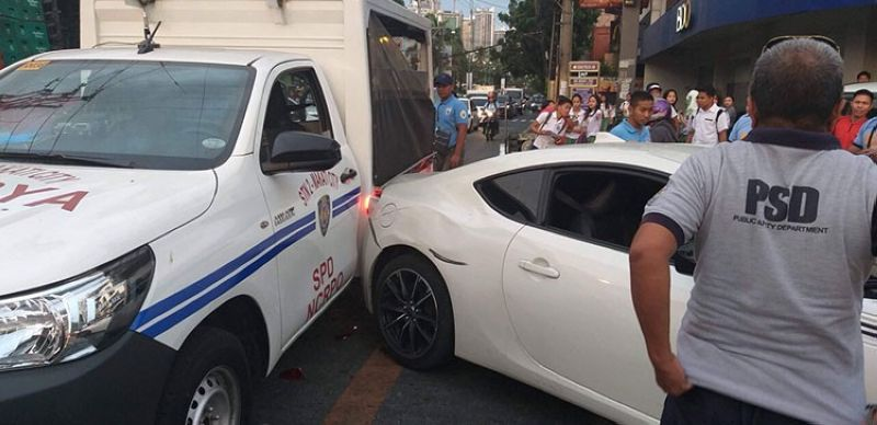 MANILA. Photo of StarStruck Season 6 Ultimate Male Survivor Migo Adecer's white sports car when it hit the police car. (Photo from Makati police)