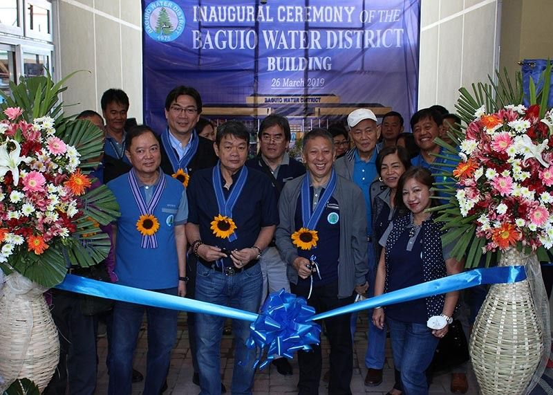 BAGUIO. Baguio Water District general manager Slavador Royeca (left), board of directors, and city officials lead the ceremonial ribbon cutting during the inauguration of the BWD building on March 26. (Photo by Jean Nicole Cortes)