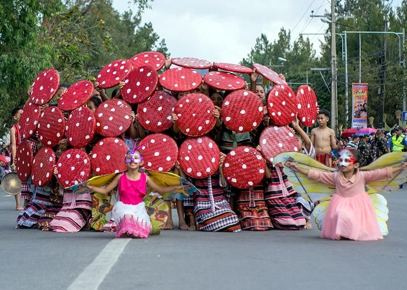 BENGUET. Students in La Trinidad, Benguet captivate the audience with their performance during the street dancing parade of the 38th Strawberry Festival. Winners in the float and street dancing category will be announced March 29. (Photo by Joven Peralta)