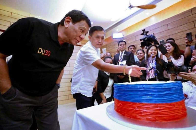 DAVAO. President Rodrigo Duterte blows a cake resembling the Philippine flag during a dinner with the Presidential Security Group at Matina Enclaves in Davao City Wednesday night, March 27, 2019. (Photo from former SAP Bong Go)