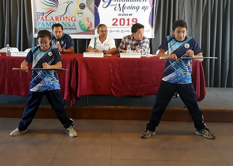 BAGUIO. Arnisadores Hana Jean Walang and Justin Apilas demonstrate their routine during a press conference. The region is hoping to improve its overall standings in the upcoming Palarong Pambansa which opens April 27 in Davao City. (Photo by Roderick Osis)