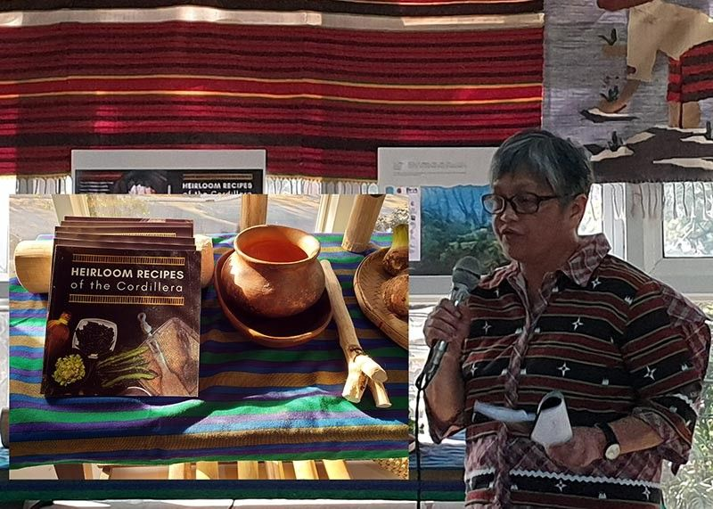 "BAGUIO. Judy Fangloy explains some features of the book ""The Heirloom Recipes of the Cordillera"" during its launching earlier this week. The book is a collection of 100 traditional recipes compiled by the Philippine Task Force for Indigenous Peoples Rights (TFIP) and the Partners for Indigenous Knowledge Philippines (PIKP). (Photo by Maria Elena Catajan)"