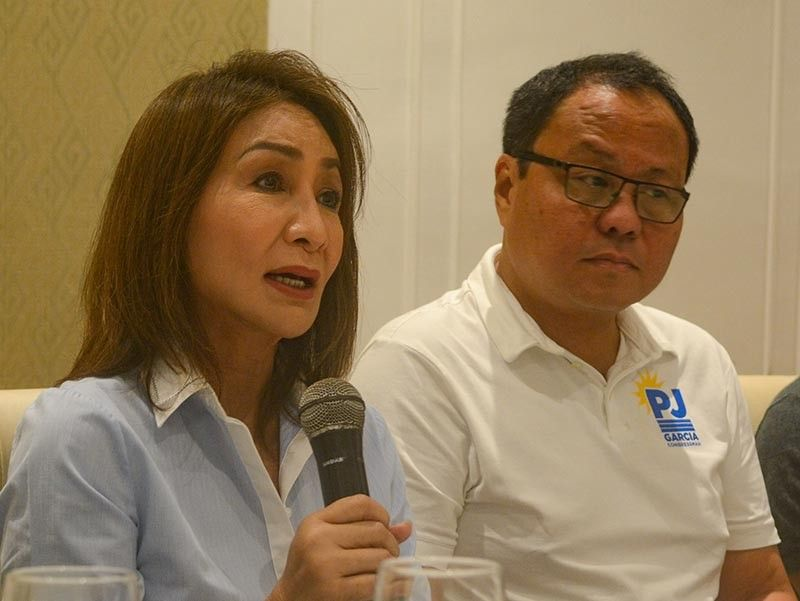 """'TORRE NI DAVIDE.' Rep. Gwendolyn Garcia and her brother Pablo John Garcia explain at a press conference on Thursday, March 28, the lapses supposedly committed by the current Capitol officials in the P1.3-billion 20-storey building project. Gwen calls the building """"Torre ni Davide"""" or the Tower of Davide. (Arni Aclao)"""