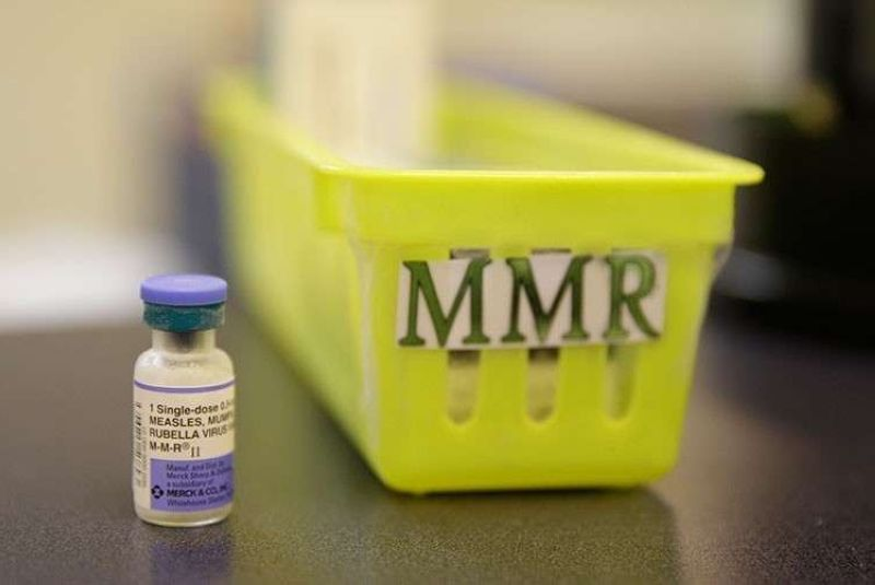 USA. This February 6, 2015, file photo shows a measles, mumps and rubella vaccine on a countertop at a pediatrics clinic in Greenbrae, California. (AP)