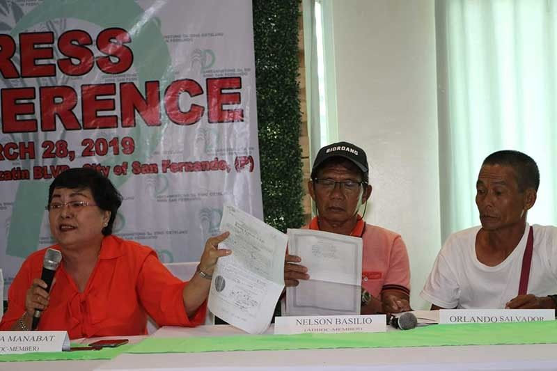 PAMPANGA. Myrna Manabat, Nelson Basilio and Orlando Salvador of the Pamisanmetung Da Ring Ortelano Ning San Fernando air the various concerns facing farmers in the City of San Fernando during a press conference Thursday, March 28. (Photo by Chris Navarro)