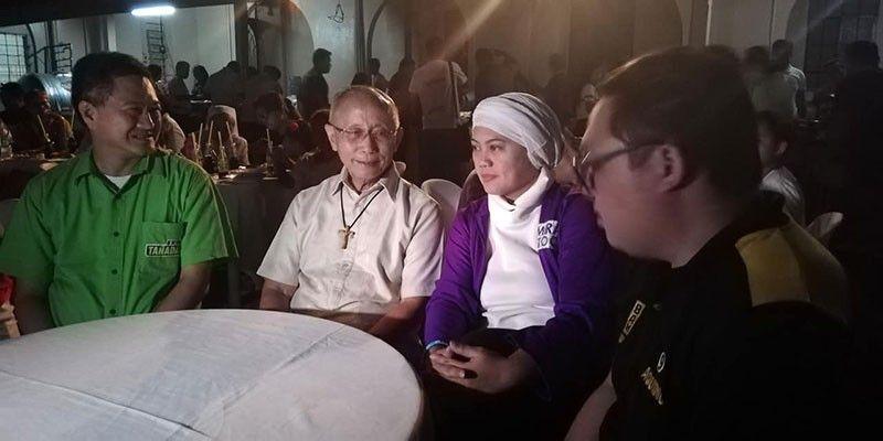 """CAGAYAN DE ORO. Outgoing Cagayan de Oro Archbishop Antonio Ledesma (center), who is set to retire this year, welcomes senatorial candidates under the opposition's """"Otso Diretso"""" during his birthday on March 28. With him are candidates Erin Tañada (left) and Samira Gutoc-Tomawis. (PJ Orias)"""