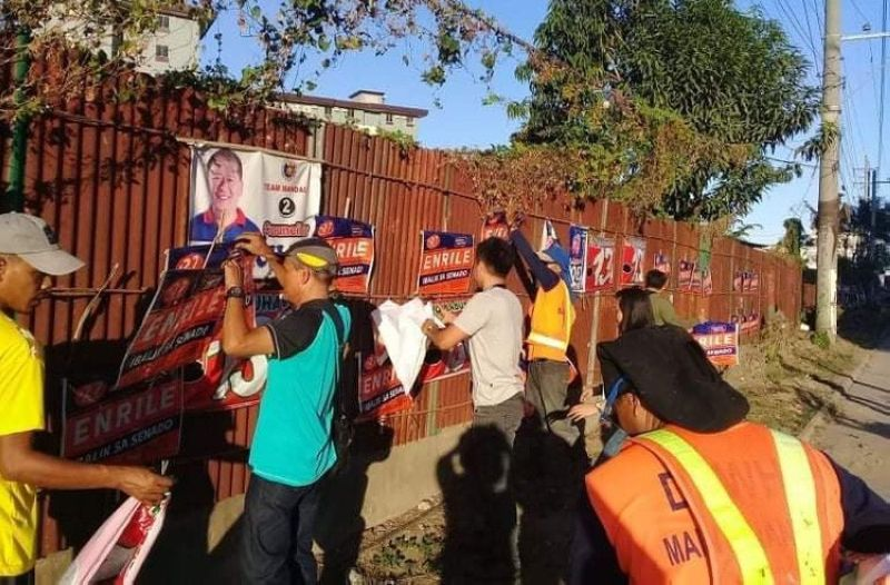 CEBU. Local election personnel lead the removal of illegally posted and oversized election paraphernalia in Mandaue City last month. This month, acting Cebu Provincial Election supervisor Jerome Brillantes is set to convene all election officers in the Province to conduct another set of