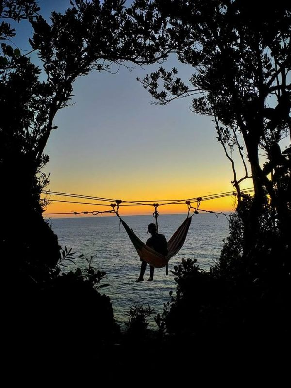 EASTERN SAMAR. The panoramic view of the Pacific sunset atop a hammock through the Huplag Adventure in Ando Island off Borongan City, the newest playground of Eastern Visayas. (Photo courtesy of Eleazar Labtic)