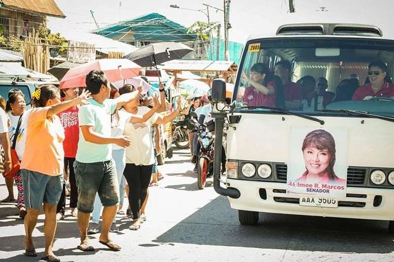 TACLOBAN CITY. Tacloban mayoral candidate Alfred Romualdez drives her cousin-senatorial candidate Imee Marcos during her campaign sorties in the city on March 31, 2019. (Photo by Tim Canes)