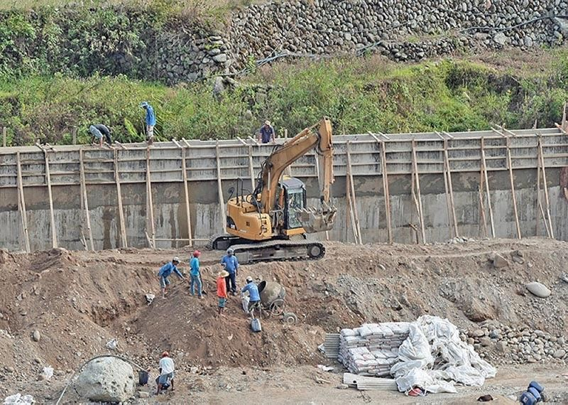 CORDILLERA. Workers build a retaining wall for the Chico River in Bontoc, Mountain Province in this file photo taken in May 2018. (SunStar Baguio File Photo)