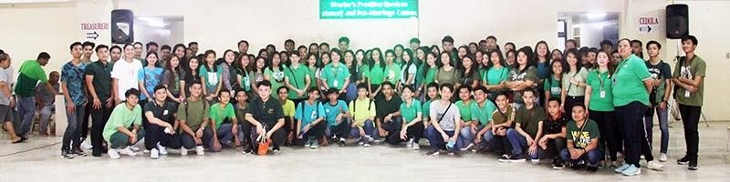 PAMPANGA. Angeles City PESO manager Maria Rosa Teodora Basilio pose with the beneficiaries of the city's Special Program for the Employment of Students (SPES) during Monday's kick-off coinciding with the flag raising rites at the city hall. The program aims to make their vacation more rewarding and worthwhile as it provides employment opportunities to indigent but deserving Angeleño students. (Photo by AC-CIO)