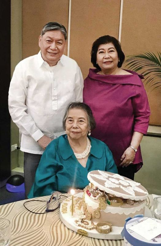 Birthday Lady. Flora Borromeo with her jewelry box birthday cake flanked by son Dindo B. and daughter Camille Suarez.