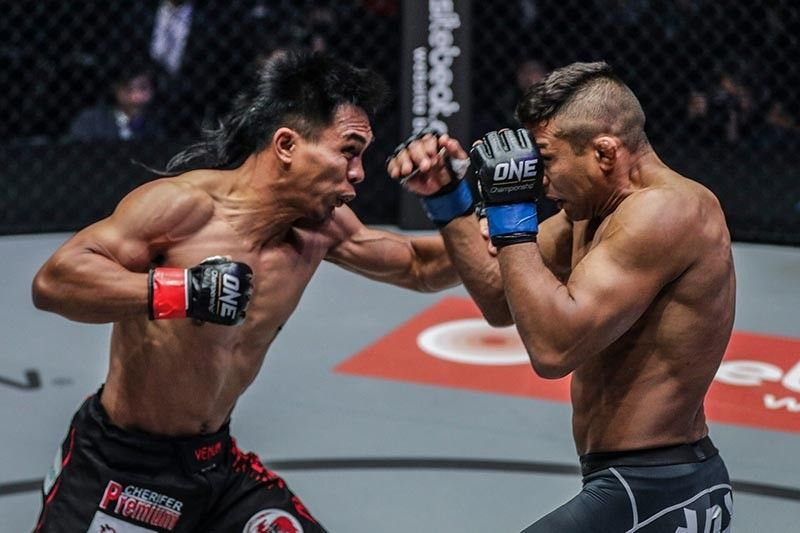 TOKYO. Kevin Belingon and Bibiano Fernandes exchange punches during their third rematch, but this was cut short after Belingon landed accidental shots in the third round which resulted in his disqualification. A rematch will soon take place. (One Championship Photo)