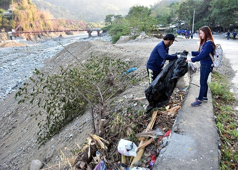 BAGUIO. More than 40 sacks of garbage were collected and hauled from the one-day plogging, jogging while picking up trash, along the Bued River and Kennon Road in celebration of the World Water Day. (Photo by Redjie Melvic Cawis)