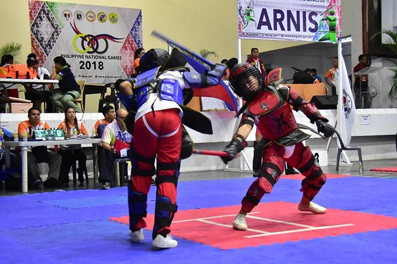 CEBU. File photo shows Glennon Jhon Malisa, right, competing in the Philippine National Games (PNG) 2018 in Mandaue City. He recently was selected as member of the Philippine national arnis male team B. (SunStar File Photo)