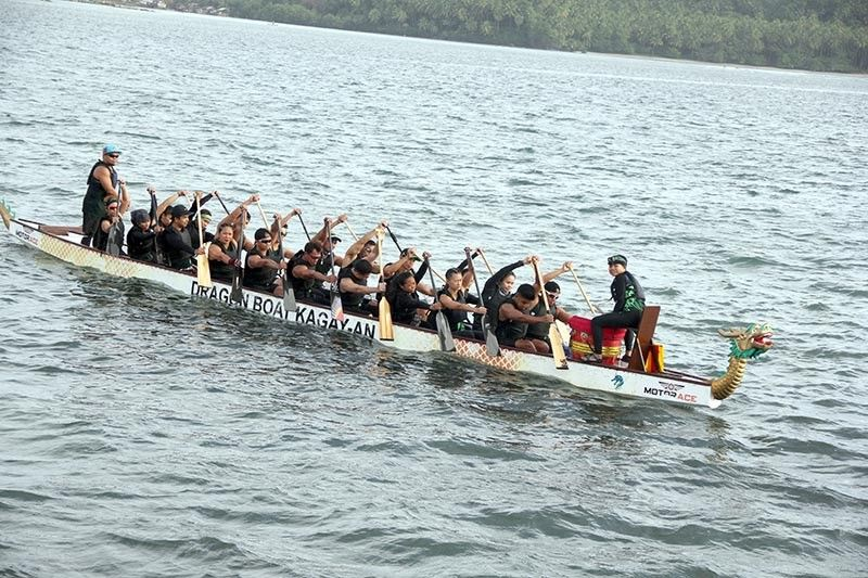 SURIGAO. Members of the Dragon Warriors Davao paddle their way to the championship trophy in standard boat mixed 2,000-meter event of the recently-concluded 6th Bugsay Mindanao Paddle for Peace in Cortes, Surigao del Sur. (Dragon Warriors Davao Photo)