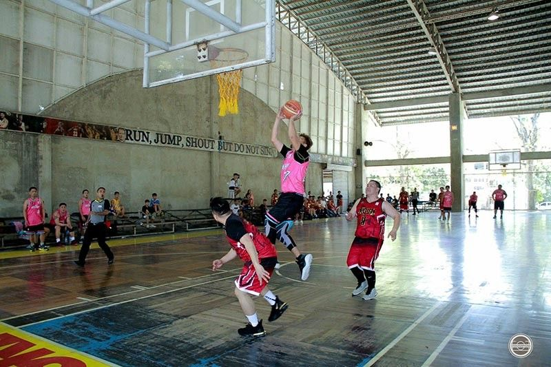 SOAR HIGH. Dos Milenyos' Chrissar Llegunas rises for a jumper against two Batch '97 defenders in a loss yesterday in Division 1 of the Don Bosco Cup. (Contributed photo / Christian June Sumalpong)