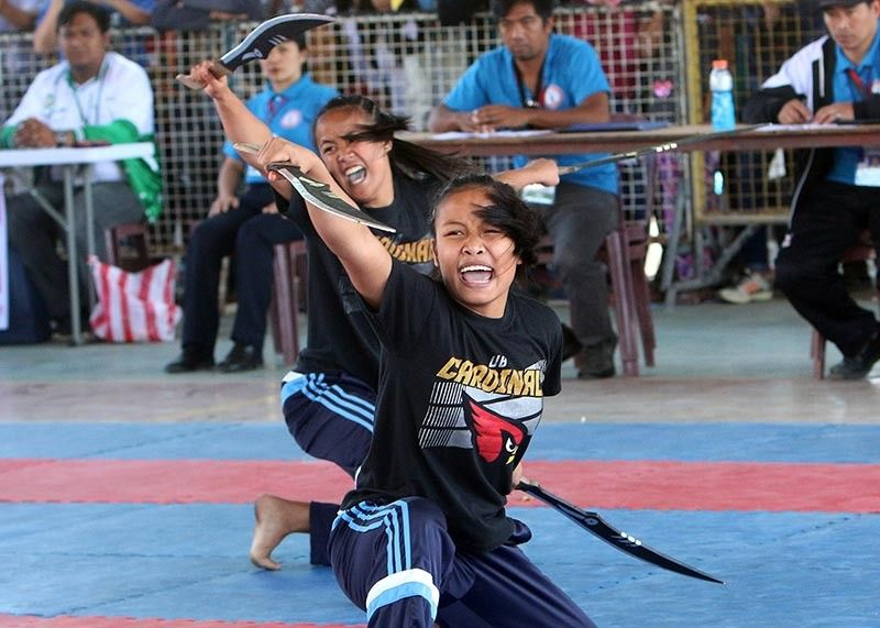 BAGUIO. Baguio's arnis squad competing in the anyo double identical weapon event during the recent Cordillera Administrative Region Athletic Association. (SSB photo)