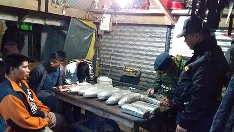 IFUGAO. Police conduct an inventory of the 11 bags of dried marijuana leaves wrapped in transparent cellophanes weighing eight kilograms worth P96,000 confiscated from two tourists in Ifugao province. (Contributed photo)