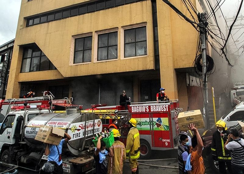 BAGUIO. Personnel of the Bureau of Fire Protection (BFP) and other volunteer groups responds to a fire which gutted grocery store along Magsaysay Avenue at around 9 a.m. Wednesday morning. (Photo by Jean Nicole Cortes)