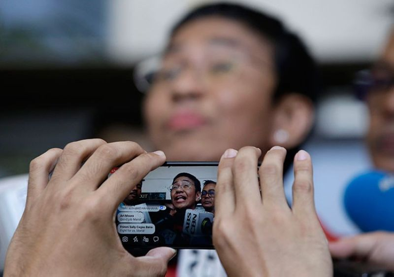MANILA. Rappler CEO and Executive Editor Maria Ressa is recorded on a smartphone as she talks to reporters after posting bail at the Pasig Regional Trial Court on March 29, 2019. (AP)