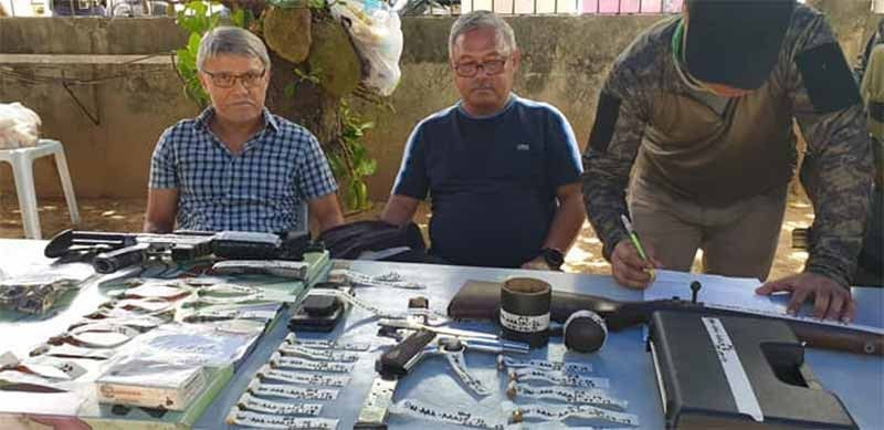 CEBU. San Francisco, Camotes Mayor Aly Arquillano (in blue shirt) and Vice Mayor Alfredo Arquillano Jr. (in checkered shirt) were arrested Thursday morning, April 4, 2019, for illegal gun possession. (Photo courtesy of Cebu Provincial Police Office)
