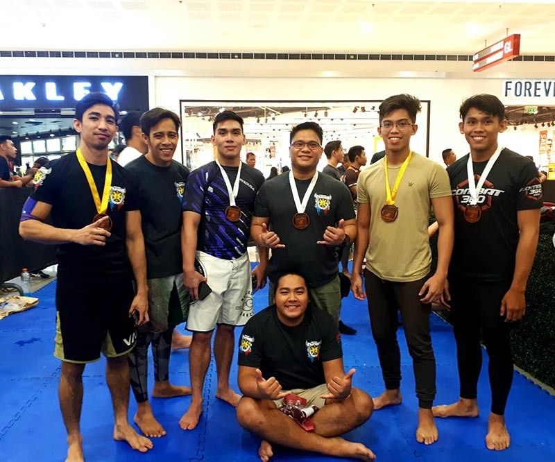 CAGAYAN DE ORO. Members of the lean Deftac Davao team pose after collecting two gold medals, three silvers and one bronze in the CDO Rollfest Nogi Jiujitsu Tournament held over the weekend at SM Downtown Premier in Cagayan de Oro City (CDO). (Dr. Jonathan Narisma)