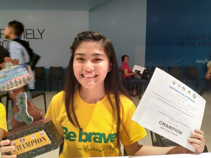DAVAO. Samantha Umayan of Davao City beams with pride as she holds her under-13 girls champion's trophy and certificate at the close of the 2019 National Youth and Schools Chess Championship-Visayas Leg in Bacolod City recently. (Merlinda Babol Umayan Facebook)