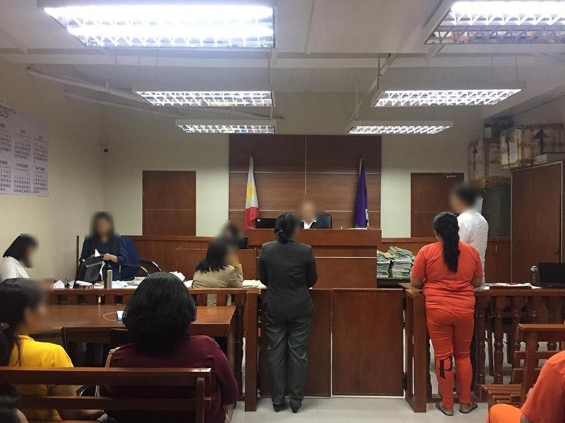 LAW IS NOT BLIND. The accused (in orange shirt), after pleading guilty to online trafficking, listens to the guilty verdict. (Contributed photo)