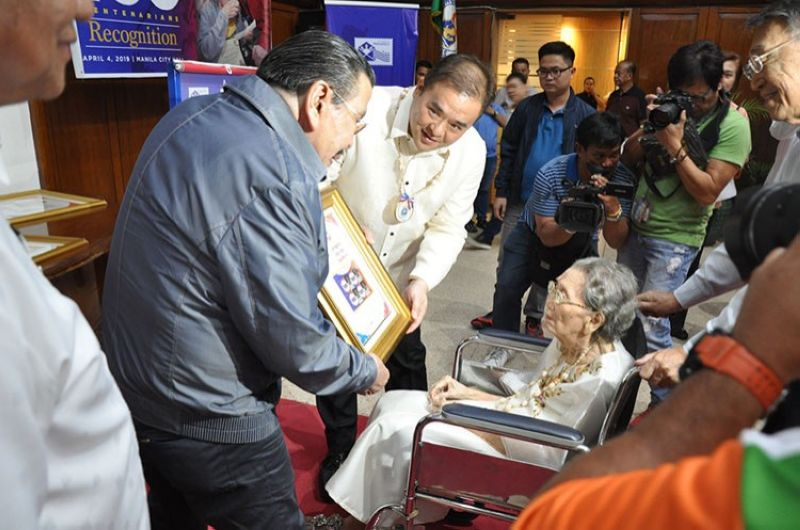 MANILA. Presentation of stamp to centenarian. (Contributed photo)