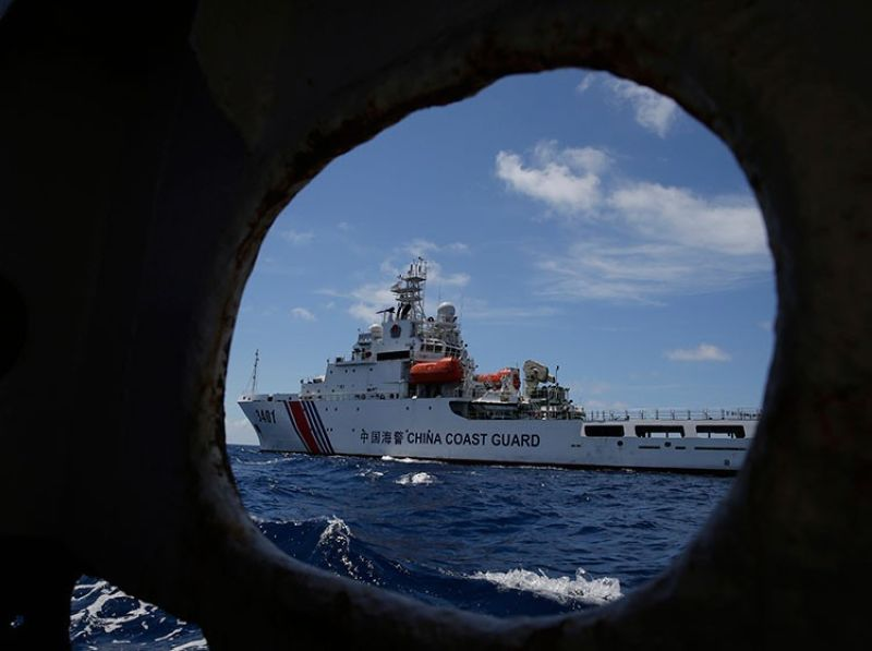 MANILA. In this photo taken March 29, 2014, a Chinese Coast Guard ship attempts to block a Philippine government vessel as the latter tries to enter Second Thomas Shoal to relieve Philippine troops and resupply provisions. (AP)