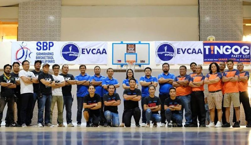 TACLOBAN CITY. Julius Ross Lacaba (back row, fifth from the right) leads the management committee of the Eastern Visayas Collegiate Athletic Association in this year's first basketball tournament. (Contributed photo)