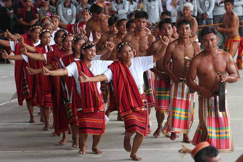 """MOUNTAIN PROVINCE. Performers from different municipalities in Bontoc, Mountain Province shows a glimpse of their rich culture and traditions through their chant and street dance performance. Mountain Province celebrates its 52nd founding anniversary and 15TH Lang-ay festival themed """"Nurturing Cultural Traditions through Indigenous People's Education."""" (Jean Nicole Cortes)"""