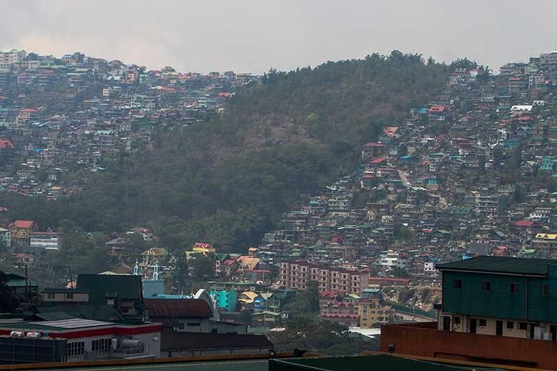 BAGUIO. In between a jungle of buildings lies Busol watershed with a total land area of 3336 hectares. Busol watershed provides approximately 40 percent of the water requirements of the people in the different villages. (Photo by Jean Nicole Cortes)