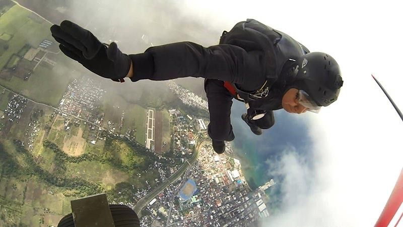 ORMOC. Police Regional Office-Eastern Visayas Director Dionardo Carlos, together with his skydiving team, kicks off the Eastern Visayas Regional  Athletic Association (Evraa) 2019 ceremony through a skydiving demonstration, the first in the history of Evraa meet, on April 7, 2019. (Photo courtesy of Dionardo Carlos)
