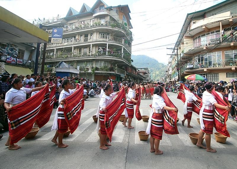 MOUNTAIN PROVINCE. Performers from different municipalities of Mountain Province show a glimpse of their rich culture and traditions through their chants and street dance performance. Mountain Province celebrated its 52nd founding anniversary and the 15th Lang-ay festival during the weekend. (Photo by Jean Nicole Cortes)