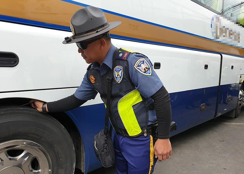 BAGUIO. A member of the Highway Patrol Group of the Police Regional Office Cordillera inspects a bus at Governor Pack Road bound for Metro Manila for roadworthiness and safety as part of the Ligtas Sumvac 2019 campaign. (Photo by Maria Elena Catajan)