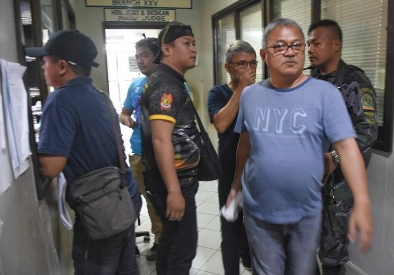 MOTION APPROVED. San Francisco  Mayor Aly Arquillano (right) and his brother Vice Mayor Alfredo Arquillano Jr. leave the sala of Danao City Regional Trial Court Branch 25 after the judge approved their request for transfer to the Danao City Jail. (SunStar photo / Allan Cuizon)