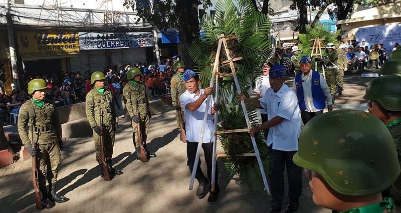CAGAYAN DE ORO. War veterans bring some commemorative flower ornaments in front of the