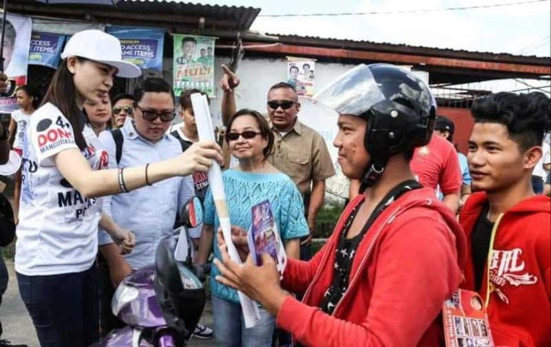 PAMPANGA. House Speaker Gloria Macapagal Arroyo accompanies Geraldine Magundadatu, wife of PDP Laban senatorial candidate Congressman Dong Mangudadatu, during a recent house-to-house sortie in Porac, Pampanga. (Contributed Photo)