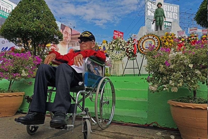 DAVAO. Unable to climb the stairs, war veteran Emmanuel Go honors the fallen heroes from his wheelchair in front of the World War II War Veterans Memorial Monument in Davao City during the celebration of the 77th Araw ng Kagitingan Tuesday, April 9. (Photo by Macky Lim)