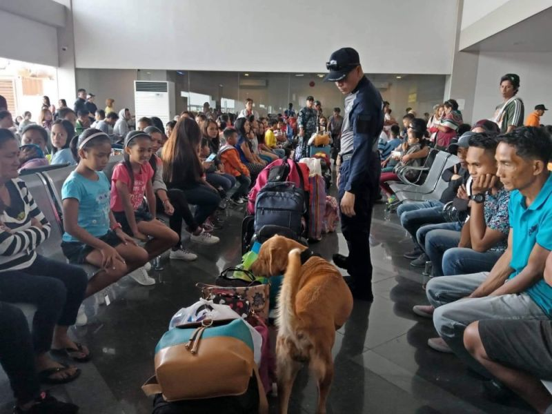 BACOLOD. A personnel of the Philippine Coast Guard along with a K9 inspect baggage of passengers at the Bacolod Real Estate Development Corp. port in Bacolod City Tuesday, April 9. (Contributed photo)