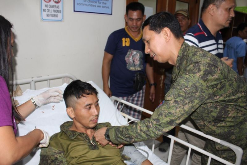 NEGROS. Brigadier General Benedict Arevalo, commander of 303rd Infantry Brigade of Philippine Army pins a medal to one of the seven soldiers who got wounded in a clash against suspected New People's Army in Barangay Buenavista, Himamaylan City, Negros Occidental Tuesday, April 9. (Contributed photo)