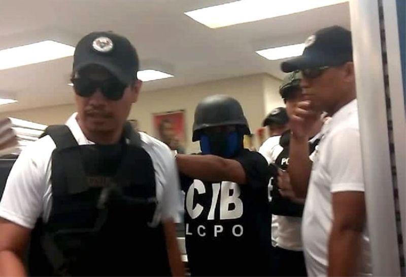 CEBU. Lapu-Lapu City Police Office personnel escort the new suspect in the killing of Christine Lee Silawan. (Fe Marie Dumaboc)