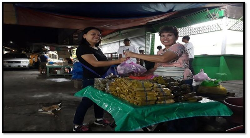 PAMPANGA. Guillerma Decear in full smile as she sells her version of suman and other kakanin at the Guiguinto public market. (Photo courtesy of PESO Guiguinto, Bulacan)