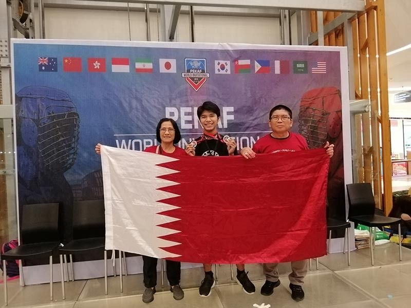 MISSION. Grandmaster Jose Eric A. Mosqueda (right) with wife Gigi (left) and student John Bernard S. Romanes  (center) during the Pekaf World Invitational Cham-pionships. (Contributed photo)