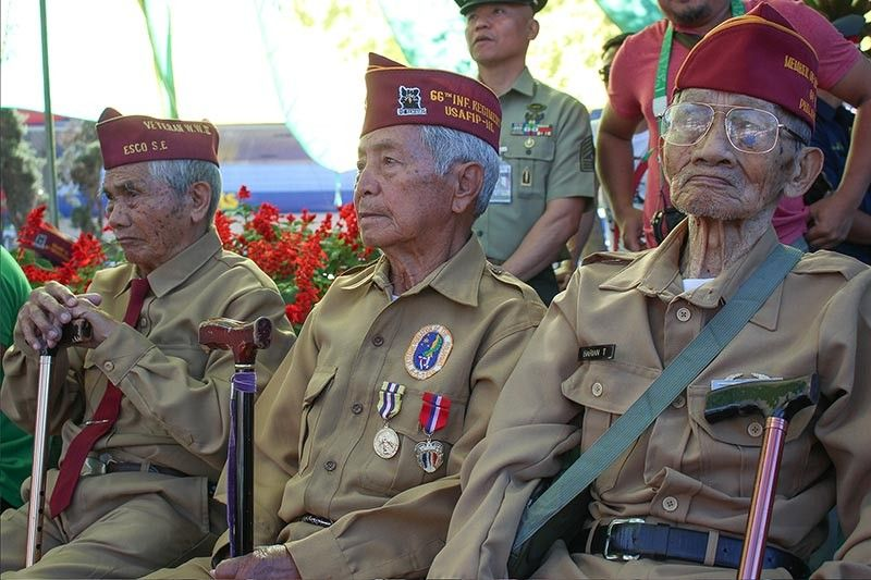"BAGUIO. World War II veterans Epifanio Besuayan, 98, Tucan Barian, 98, and Esteban Esco, 94 attend the 77th anniversary of the Fall of Bataan on April 9 at the Veterans Park in Baguio City. The week from April 9 to April 15 has been designated as Philippine Veterans Week ""in order to promote, preserve and memorialize the principles, ideas and deeds of the Filipino war veterans as means to enhance patriotism and love of country, especially among the youth of the land."" (Photo by Jean Nicole Cortes)"